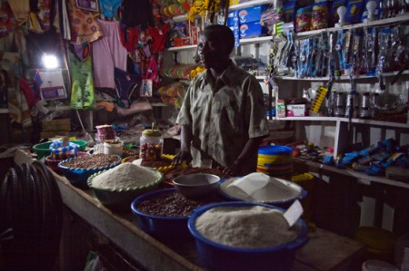 A shop keeper in rural area use solar lantern to light up the shop